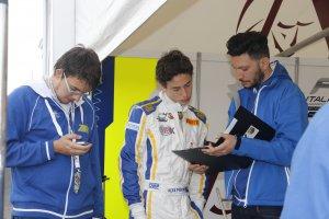 Examining data with race engineer Ruggero