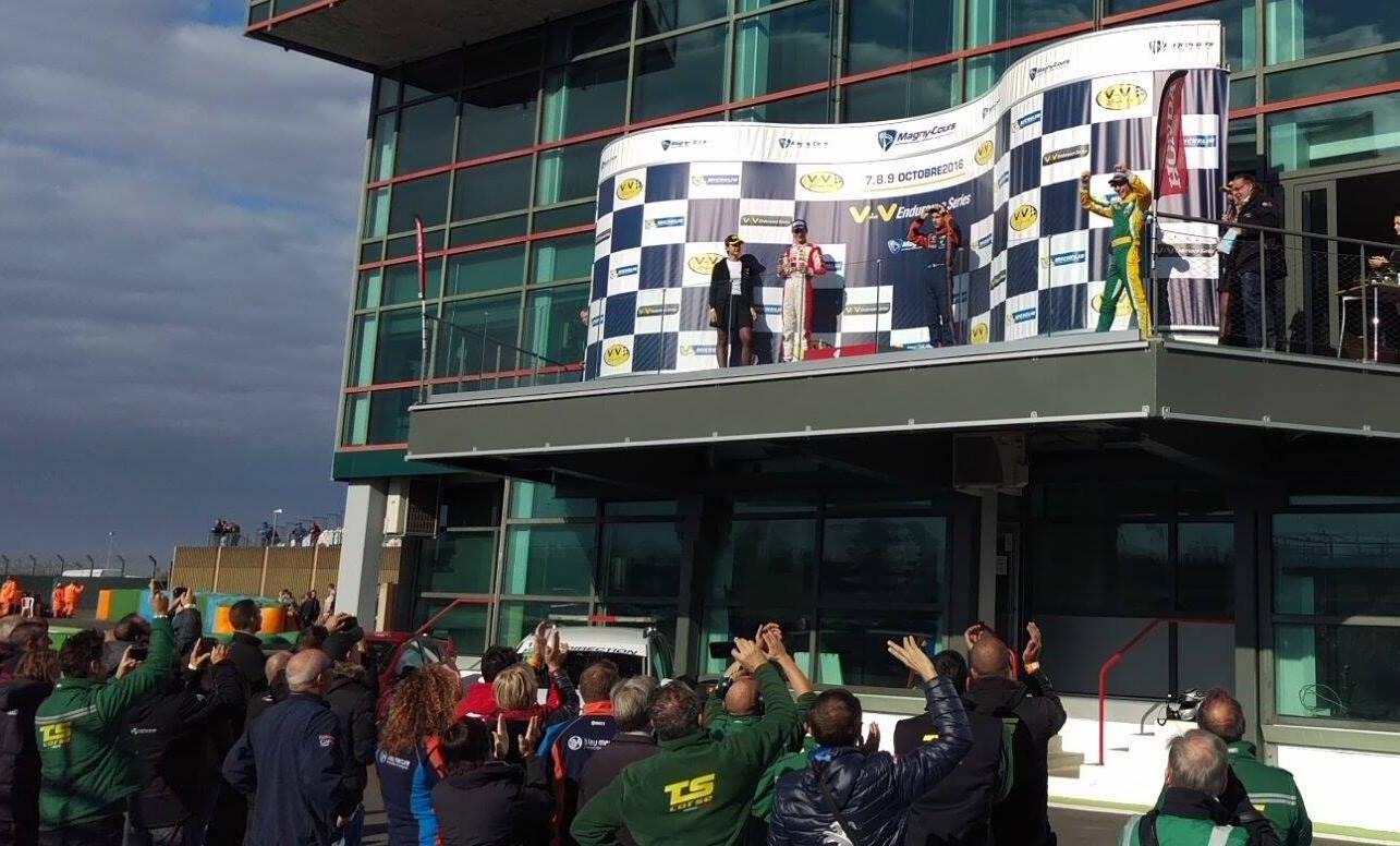 Celebrating on the podium